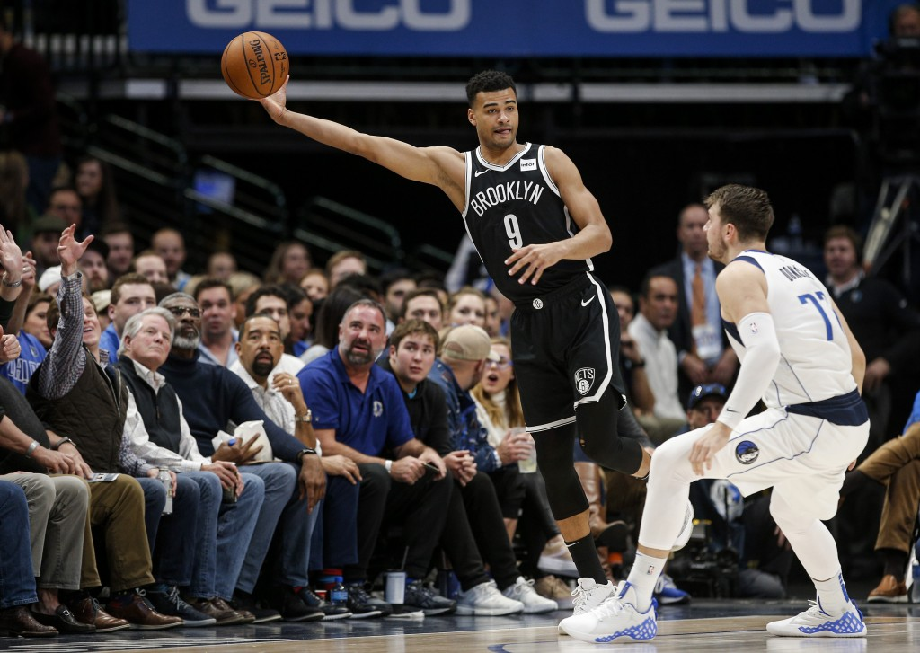 Brooklyn Nets guard Timothe Luwawu-Cabarrot (9) reaches for the ball as Dallas Mavericks forward Luka Doncic (77) defends during the first half of an ...