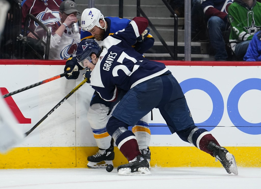 Colorado Avalanche defenseman Ryan Graves (27) and St. Louis Blues center Ryan O'Reilly (90) vie for the puck along the boards during the second perio...