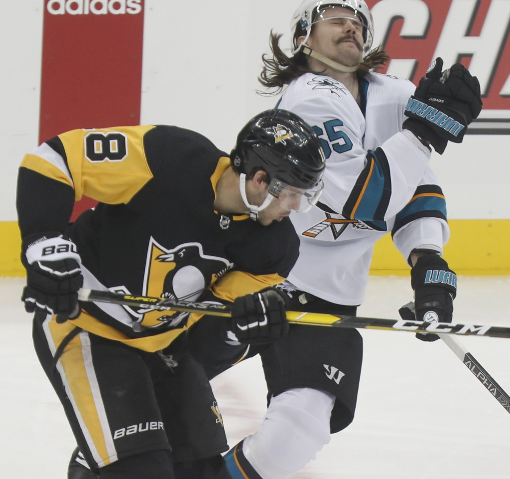 San Jose Sharks' Erik Karlsson (65) reacts after getting by Pittsburgh Penguins' Alex Galchenyuk (18) during the first period of an NHL hockey game Th...