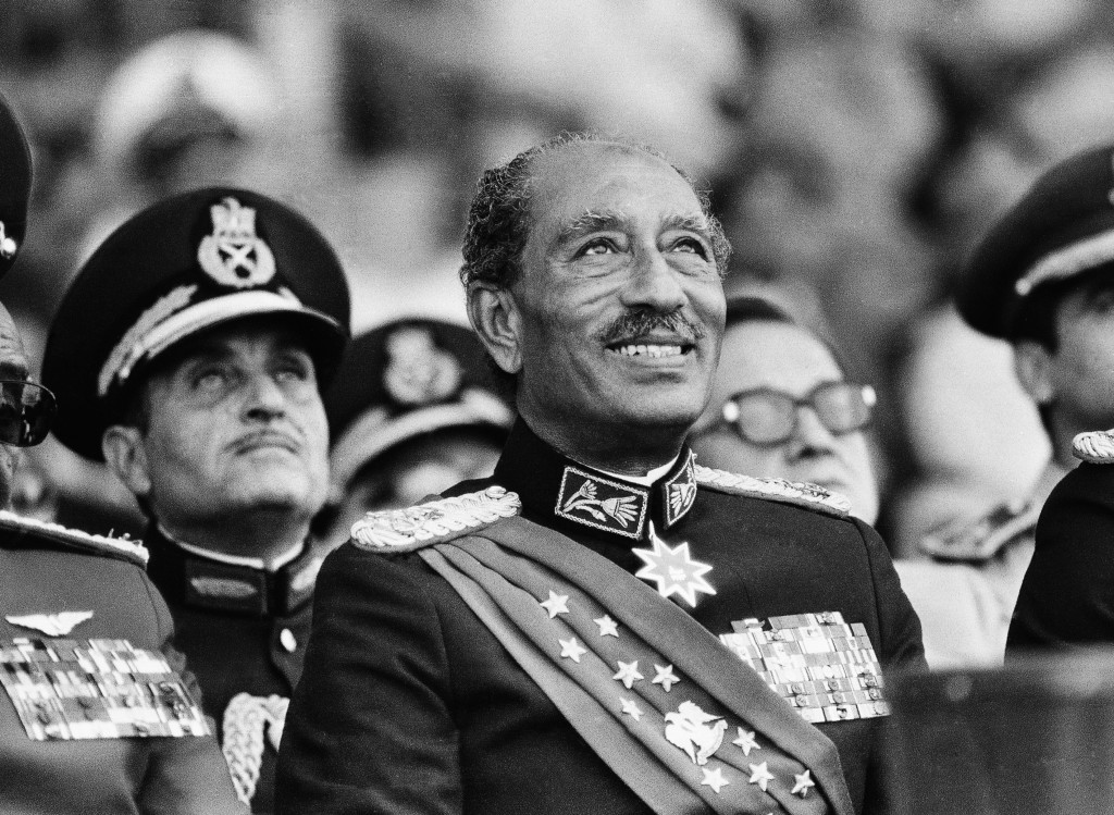 FILE - In this Oct. 6, 1981 file photo, Egyptian President Anwar Sadat smiles at the start of the military parade in Cairo. Later, during the parade, ...