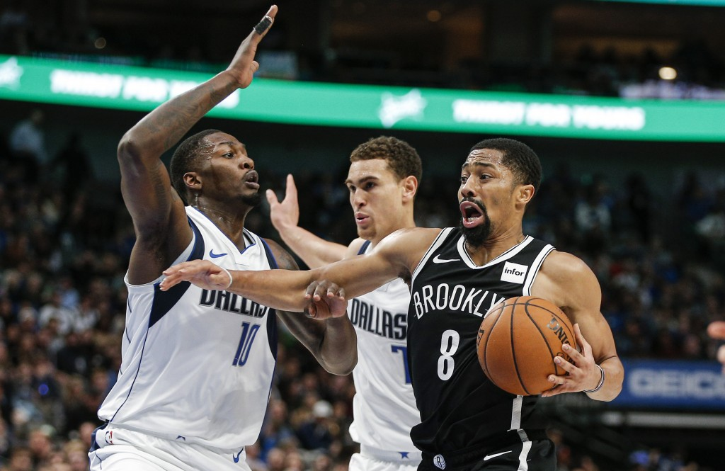 Brooklyn Nets guard Spencer Dinwiddie (8) works against Dallas Mavericks forwards Dorian Finney-Smith (10) and Dwight Powell (7) during the second hal...