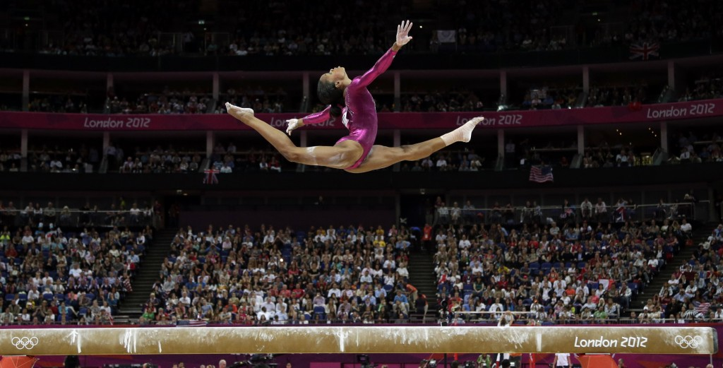FILE - In this Aug. 2, 2012, file photo U.S. gymnast Gabby Douglas performs on the balance beam during the artistic gymnastics women's individual all-...