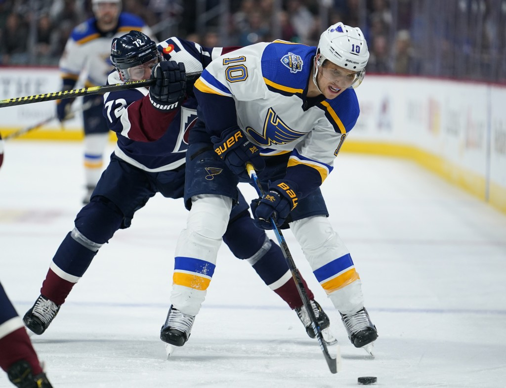 St. Louis Blues center Brayden Schenn (10) is pressured by Colorado Avalanche right wing Joonas Donskoi (72) during the second period of an NHL hockey...