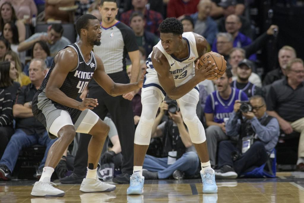 Sacramento Kings forward Harrison Barnes (40) defends against Memphis Grizzlies forward Jaren Jackson Jr. (13) during the first quarter of an NBA bask...