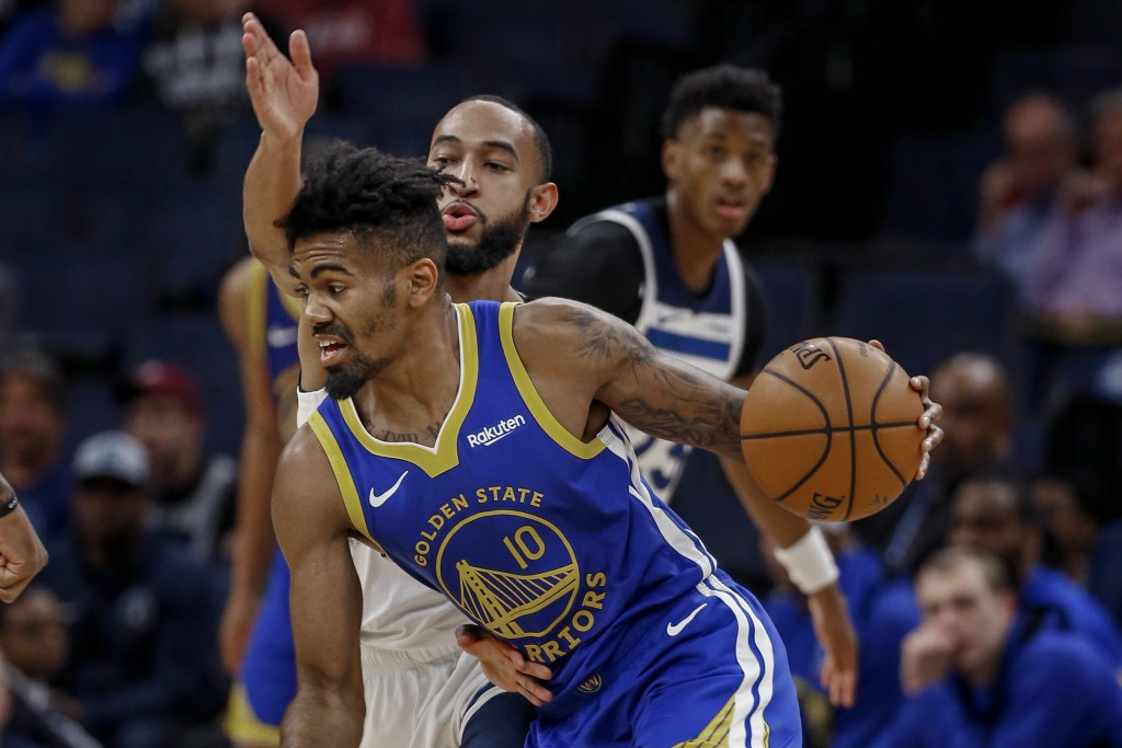 Golden State Warriors guard Jacob Evans (10) drives around Minnesota Timberwolves guard Jordan McLaughlin (6) in the first half of an NBA basketball g...