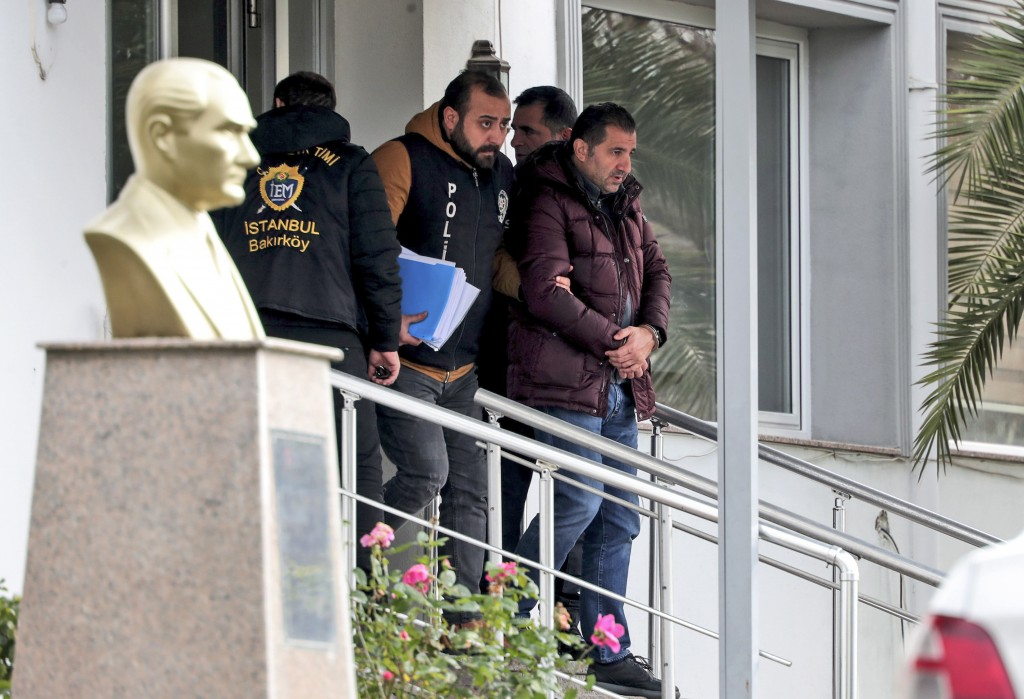 Turkish police officers escort suspects, accused of involvement of Nissan's former CEO Carlos Ghosn passage through Istanbul, after he fled Japan, in ...