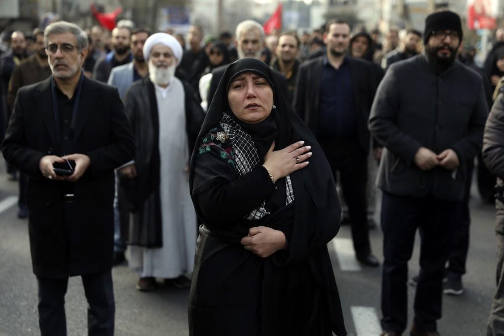 A woman mourns in a demonstration over the U.S. airstrike in Iraq that killed Iranian Revolutionary Guard Gen. Qassem Soleimani in Tehran, Iran, Jan. ...
