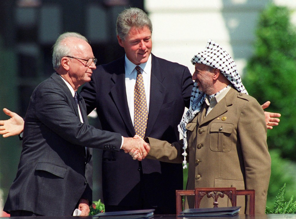 FILE - In this Sept. 13, 1993 file photo President Clinton presides over White House ceremonies marking the signing of the peace accord between Israel...