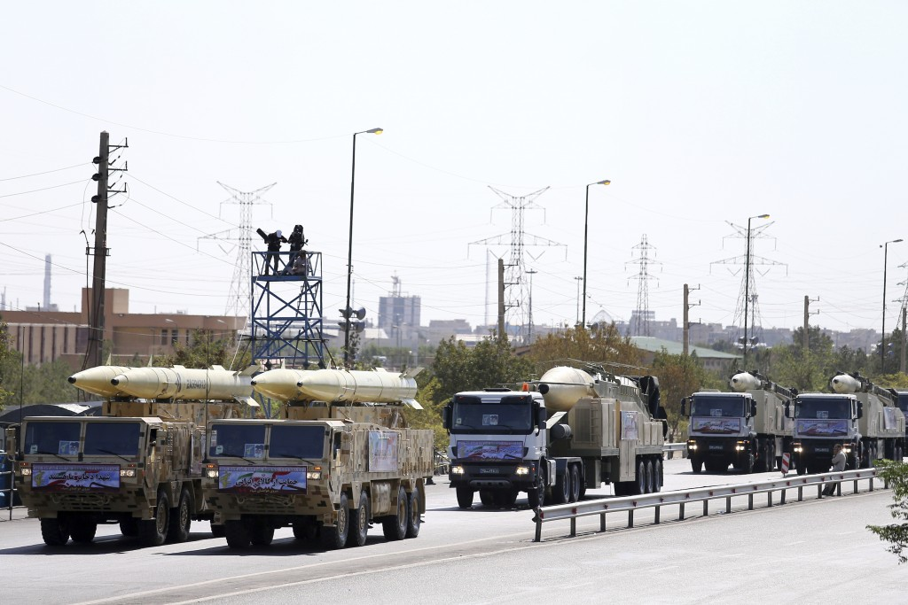 FILE - In this Sept. 22, 2018, file photo, Iran's missiles are displayed by the Revolutionary Guard during a military parade marking the the 38th anni...