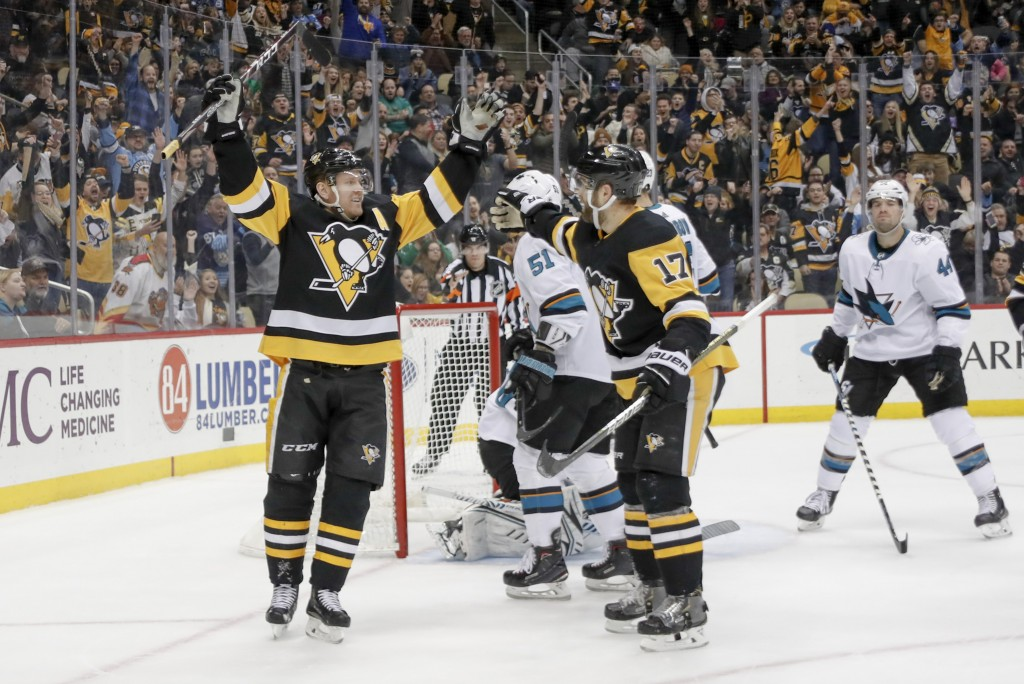 Pittsburgh Penguins' Patric Hornqvist (72) celebrates with Bryan Rust (17) after scoring against the San Jose Sharks during the second period of an NH...