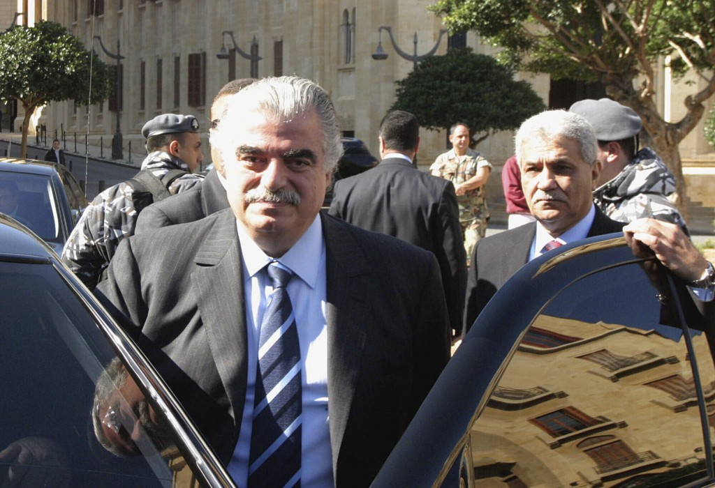 FILE - In this Feb. 14, 2005 file photo, former Prime Minister Rafik Hariri, left, and his bodyguard Yahya Arab, leave the Parliament in Beirut, Leban...