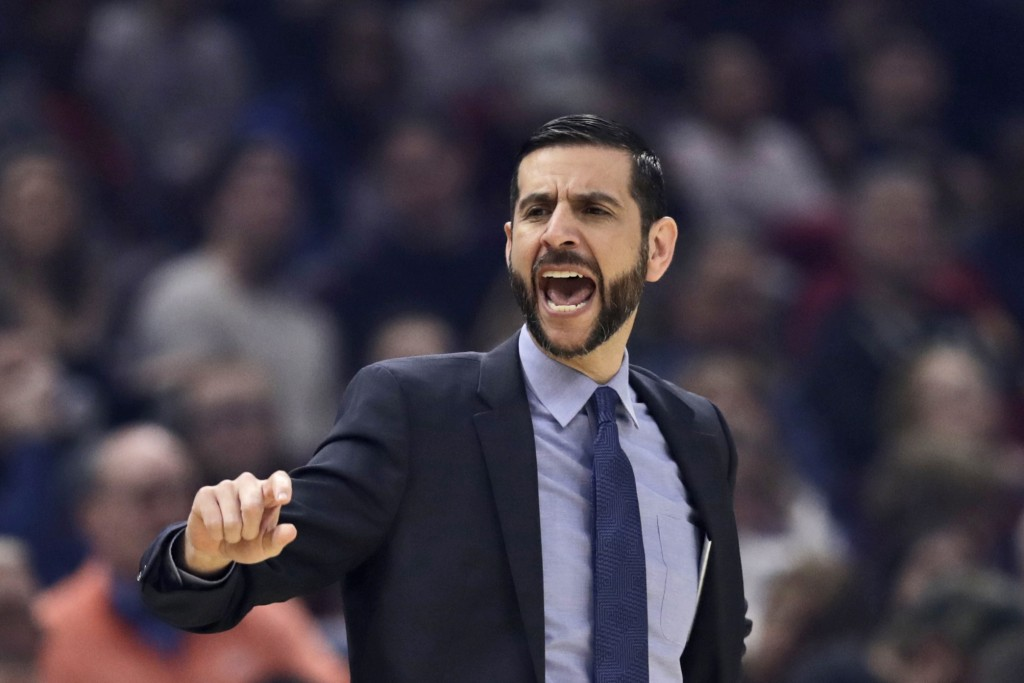 Charlotte Hornets head coach James Borrego yells instructions to players in the first half of an NBA basketball game against the Cleveland Cavaliers, ...