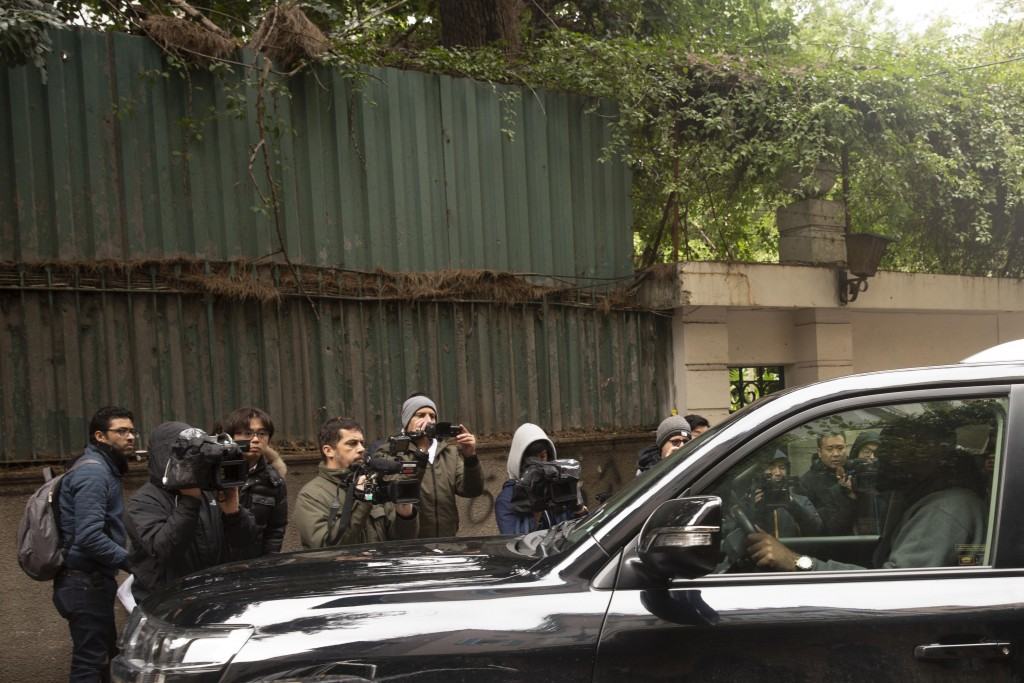 Journalists film a vehicle leaving the house of ex-Nissan chief Carlos Ghosn in Beirut, Lebanon, Friday, Jan. 3, 2020. The former Nissan Motor Co. Cha...