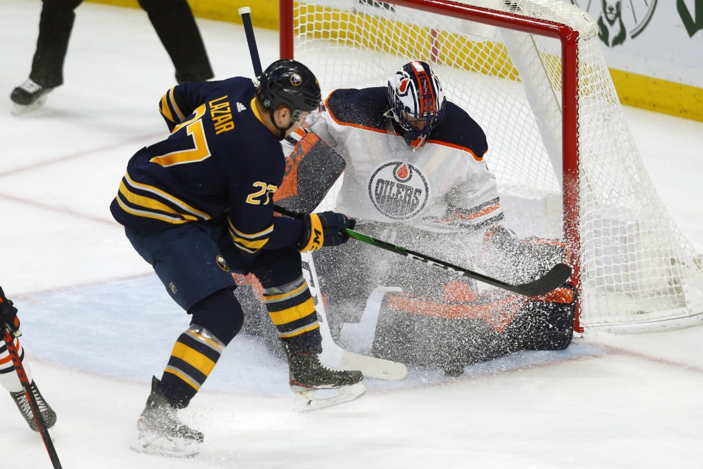 Buffalo Sabres forward Curtis Lazar (27) is stopped by Edmonton Oilers goalie Mike Smith (41) during the first period of an NHL hockey game Thursday, ...