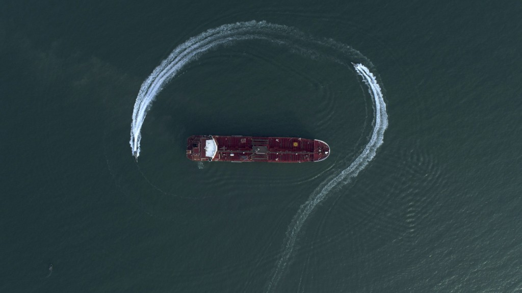 FILE - Speedboats from Iran's Revolutionary Guard circle the British-flagged oil tanker Stena Impero on Sunday, July 21, 2019 in the Iranian port of B...