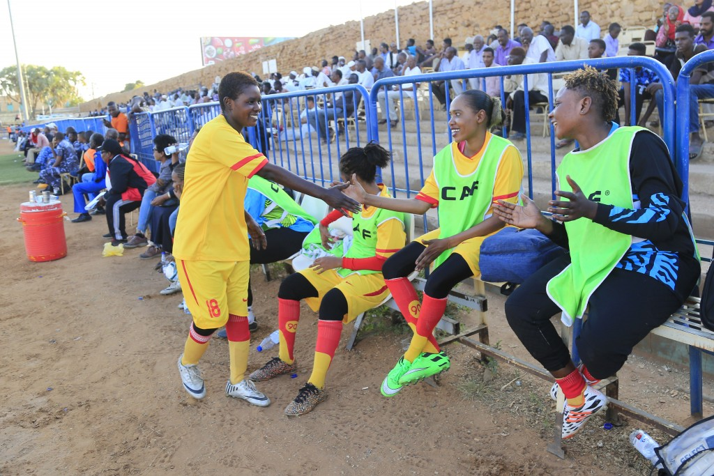 In this Wednesday, Dec. 11, 2019 photo, Sudanese , al-Sumood players sit on the bench durin a game with al-Difaa women teams in Omdurman, Khartoum's t...