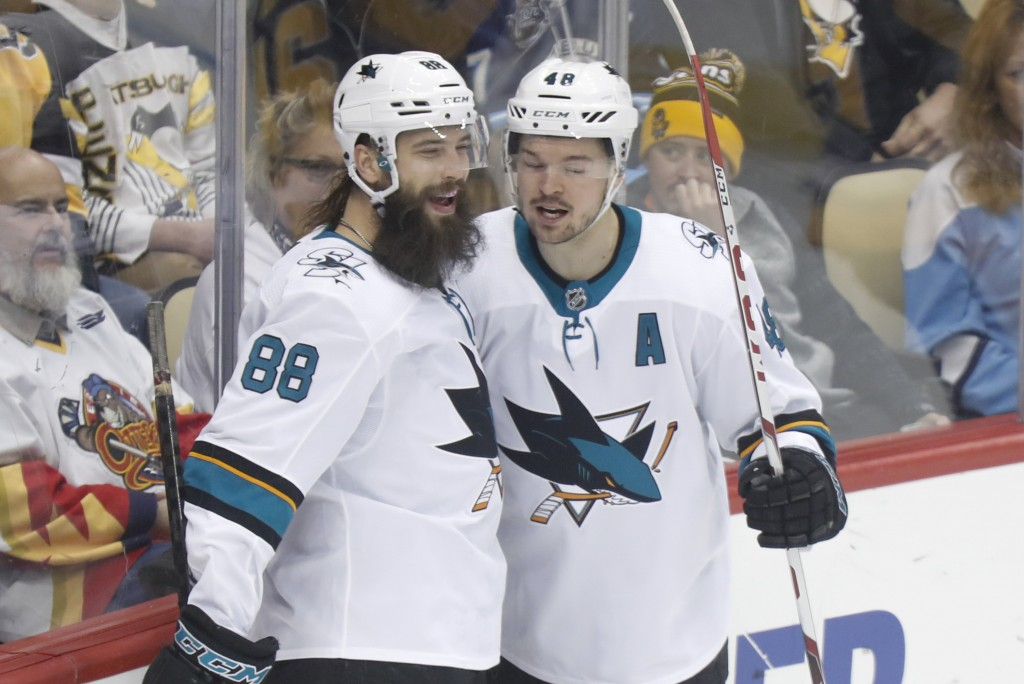 San Jose Sharks' Tomas Hertl, right, celebrates with Brent Burns (88) after scoring against the Pittsburgh Penguins during the first period of an NHL ...