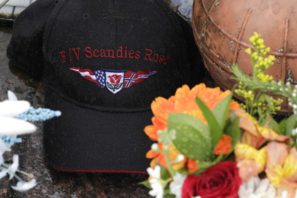 Rain drops gather on a ball cap with the name of the crab fishing boat Scandies Rose, a 130-foot crab fishing boat from Dutch Harbor, Alaska, that san...