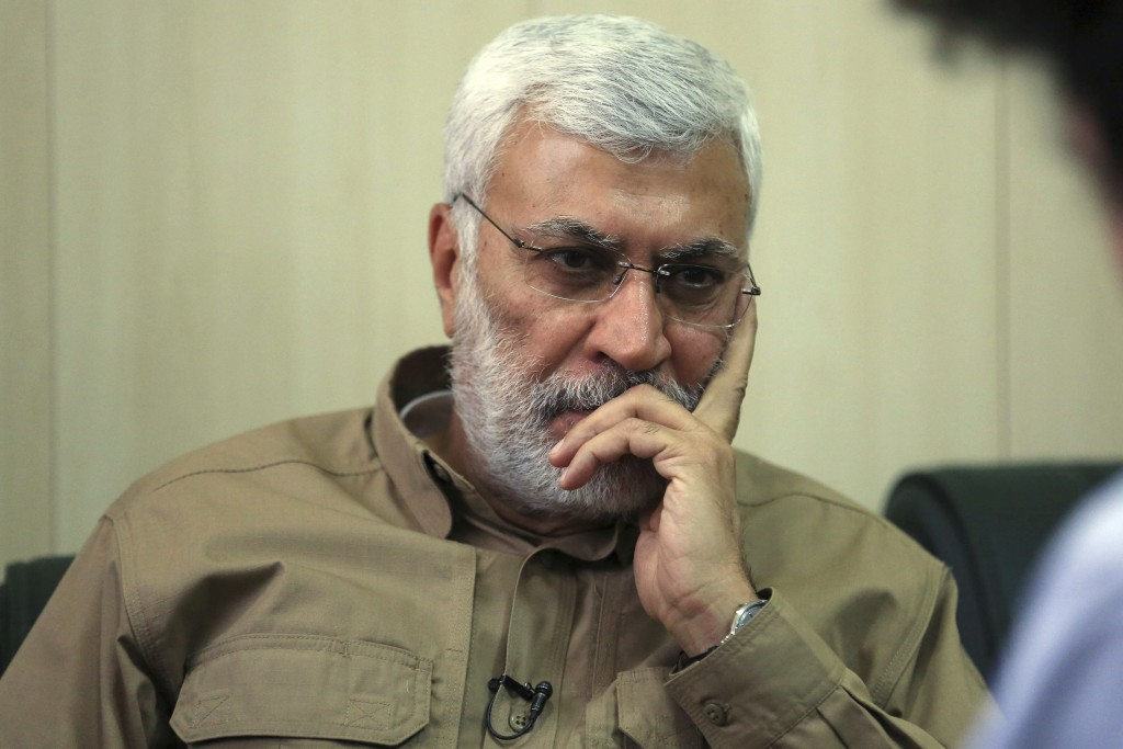 FILE - In this May 29, 2016, file photo, Abu Mahdi al-Muhandis listens to a question during an interview in Fallujah, Iraq. Al-Muhandis, a veteran Ira...