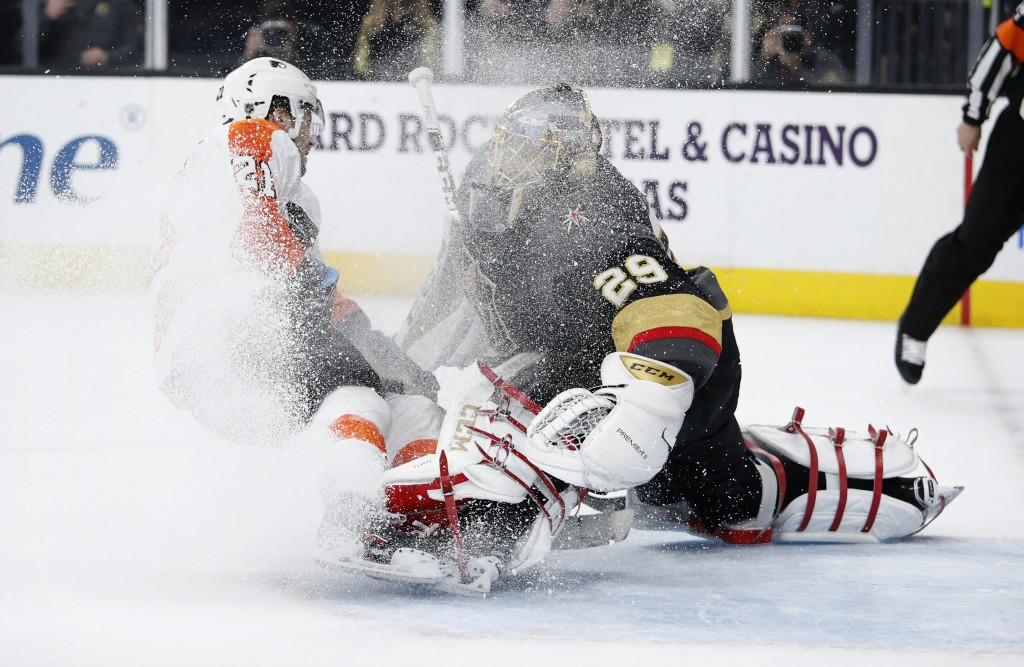 Vegas Golden Knights goaltender Marc-Andre Fleury (29) blocks a penalty shot by Philadelphia Flyers center Scott Laughton (21) during the first period...