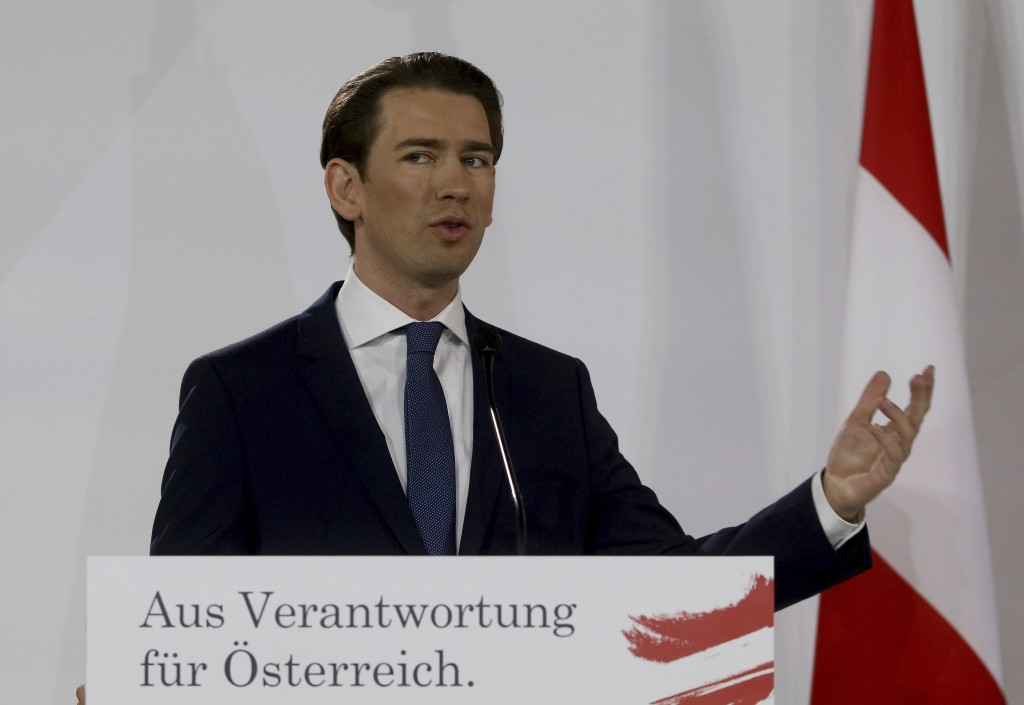 Sebastian Kurz head of the Austrian People's Party, OEVP, speaks to journalists during a press conference about the government program with Werner Kog...