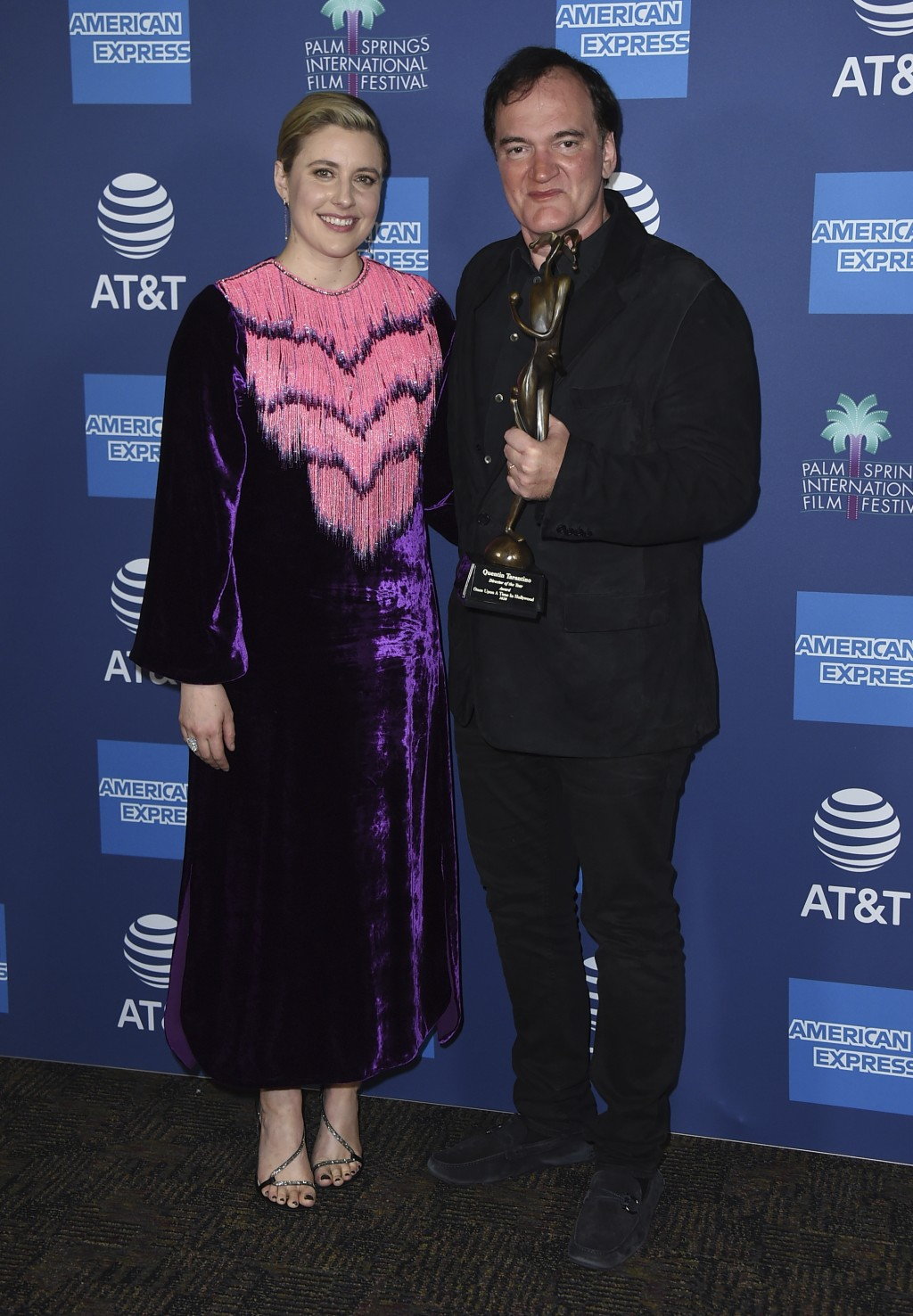 """Greta Gerwig, left, and Quentin Tarantino, winner of the director of the year award for his film """"Once Upon a Time ... in Hollywood,"""" pose in the pres..."""