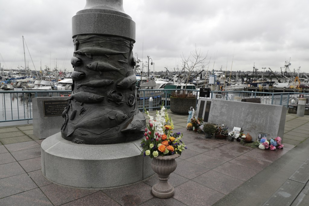 The Seattle Fishermen's Memorial is shown Thursday, Jan. 2, 2020 in Seattle. Items left at the memorial Thursday included a ball cap with the name of ...