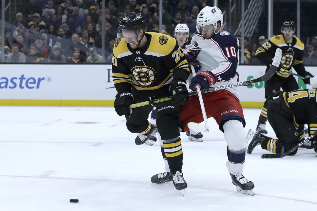 Boston Bruins center Joakim Nordstrom (20) and Columbus Blue Jackets center Alexander Wennberg (10) compete for the puck in the second period of an NH...