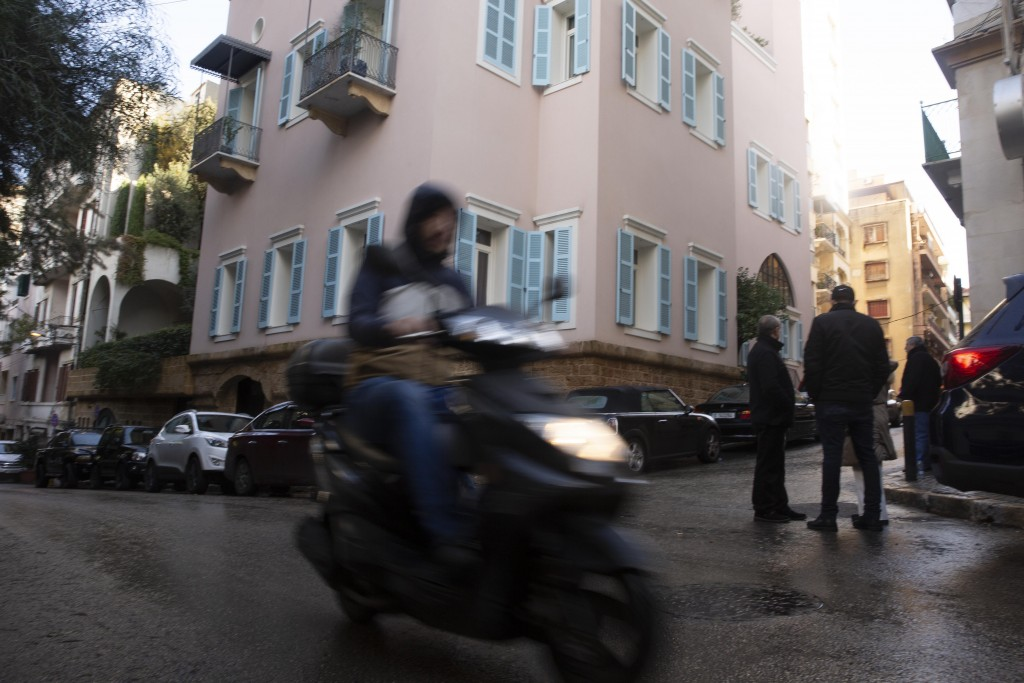 A motorbike passes the house of ex-Nissan chief Carlos Ghosn in Beirut, Lebanon, Friday, Jan. 3, 2020. The former Nissan Motor Co. Chairman fled Japan...