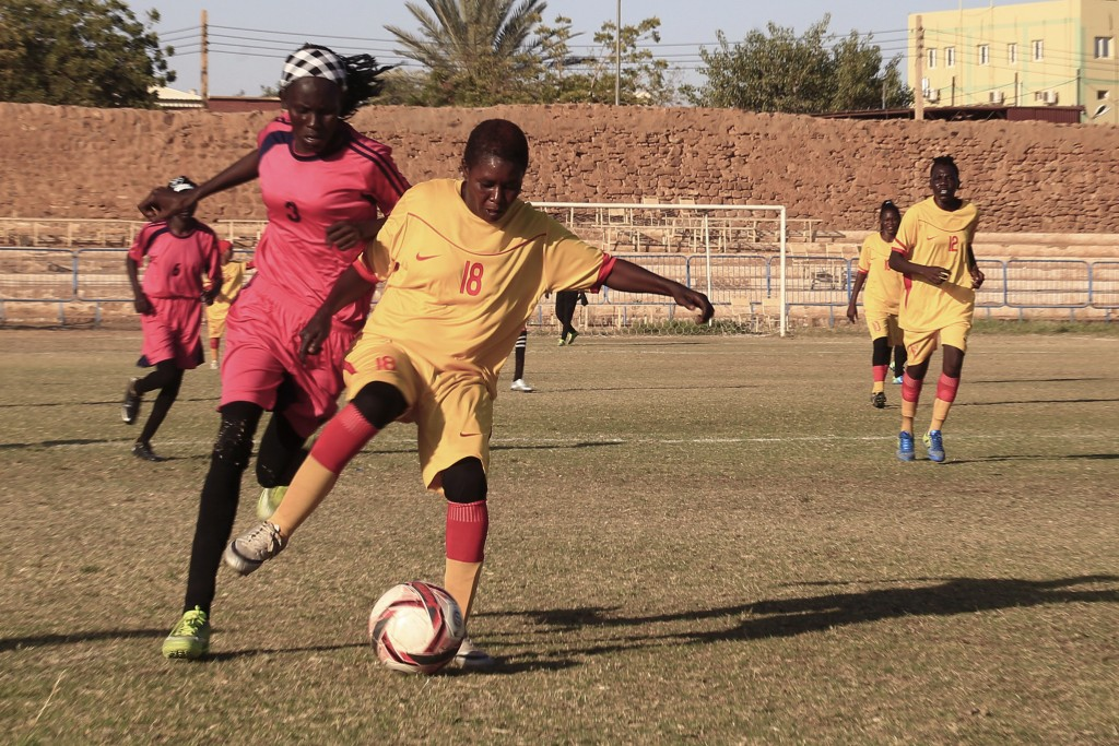 In this Wednesday, Dec. 11, 2019 photo, Sudanese al-Difaa, in pink, and al-Sumood women teams play in Omdurman, Khartoum's twin city, Sudan. The women...