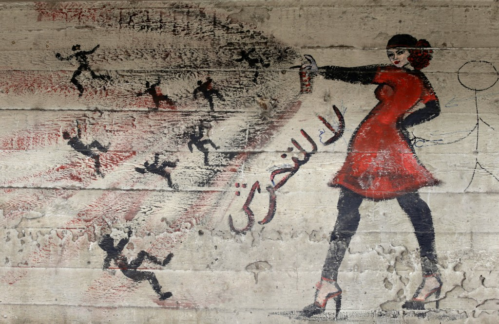 """FILE - In this May 24, 2013 file photo, a mural with Arabic that reads """"no harassment,"""" is seen on a wall in Cairo, Egypt.  A video from Egypt showing..."""