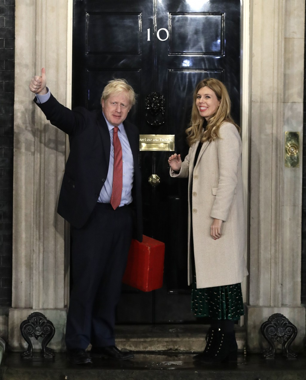 FILE - In this file photo dated Friday, Dec. 13, 2019, Britain's Prime Minister Boris Johnson stands with his partner Carrie Symonds, on the steps of ...