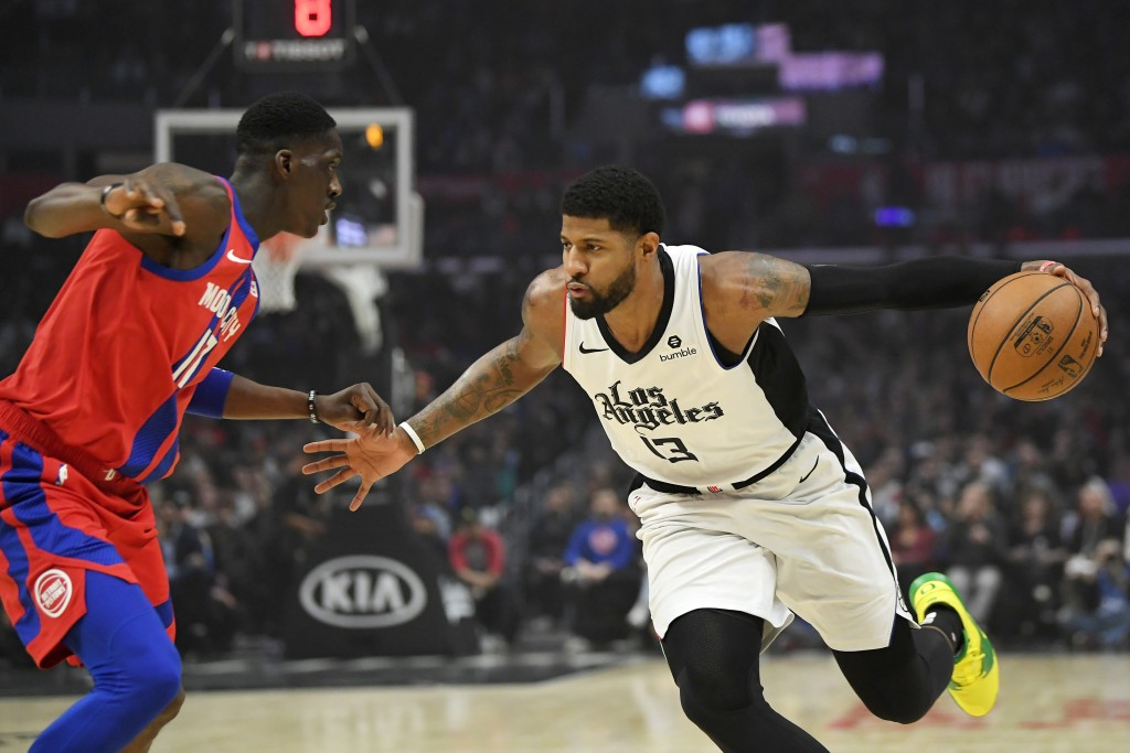 Los Angeles Clippers forward Paul George, right, tries to drive past Detroit Pistons guard Tony Snell during the first half of an NBA basketball game ...
