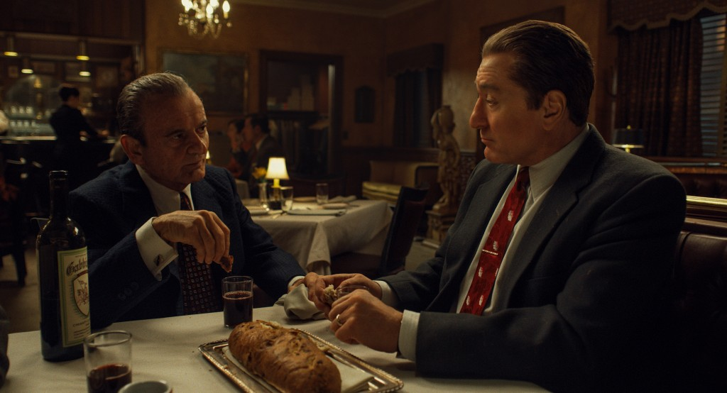 "This image released by Netflix shows Joe Pesci, left, and Robert De Niro in a scene from ""The Irishman."" The film is nominated for a Golden Globe for ..."