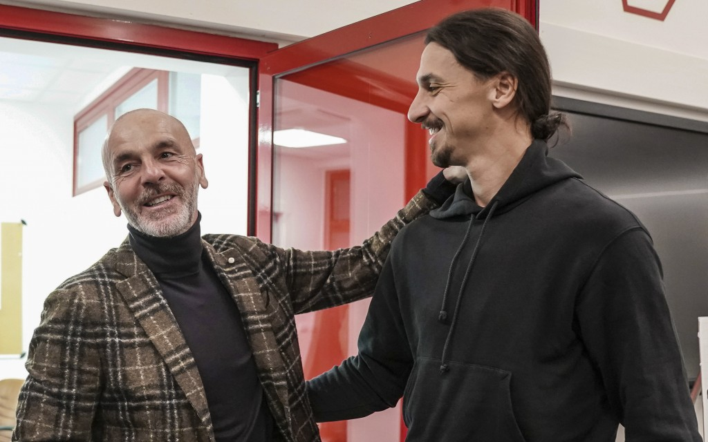 Zlatan Ibrahimovic, right, meets AC Milan coach Stefano Pioli, at the team's headquarters, in Milan, Italy, Thursday, Jan. 2, 2020.  The 38-year-old s...