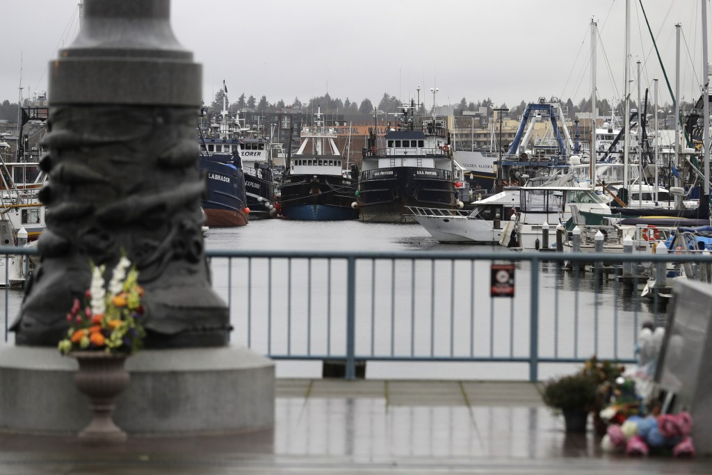 Fishing and boats used for other purposes are shown parked near the Seattle Fishermen's Memorial, Thursday, Jan. 2, 2020, in Seattle. Items left at th...