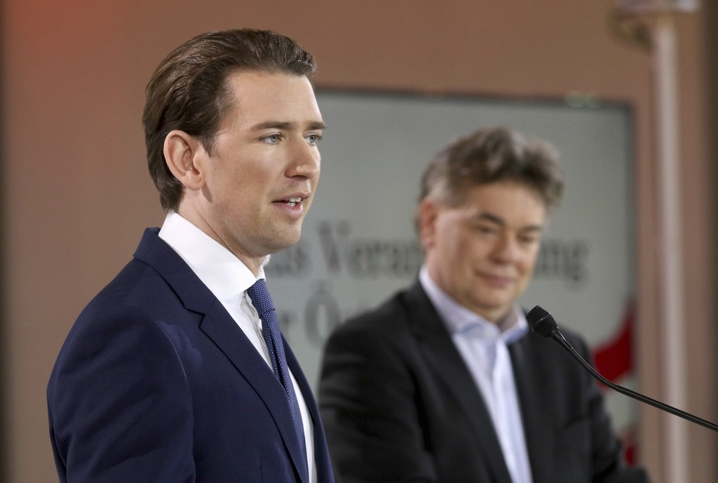 Sebastian Kurz, left, head of the Austrian People's Party, OEVP, and Werner Kogler, right, head of the Austrian Greens speak to journalists during a p...