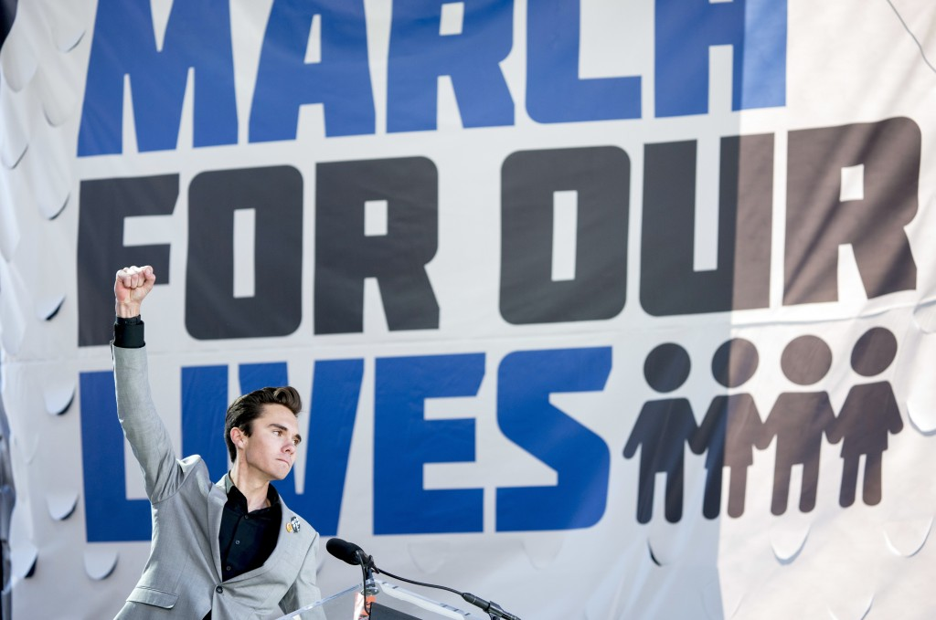 FILE - In this March 24, 2018, file photo, David Hogg, a survivor of the mass shooting at Marjory Stoneman Douglas High School in Parkland, Fla., rais...