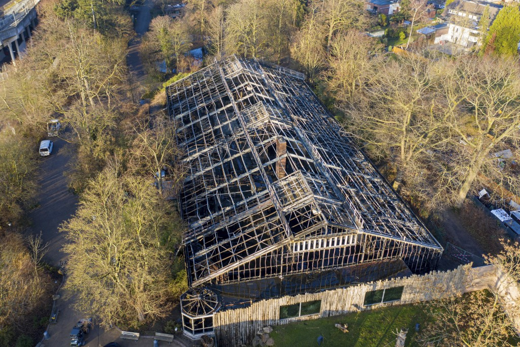 This Jan. 1, 2020 photo, shows a burned down animal house at the Zoo in Krefeld, Germany. Three woman are under investigation for launching paper sky ...