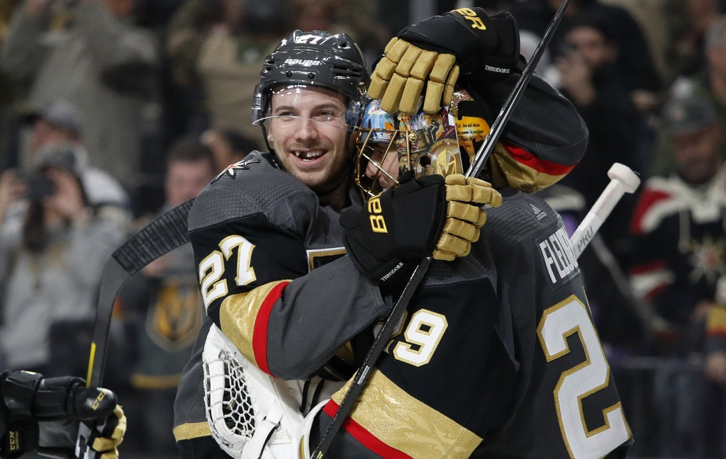 Vegas Golden Knights defenseman Shea Theodore (27) embraces goaltender Marc-Andre Fleury (29) after the team's win over the Philadelphia Flyers in an ...
