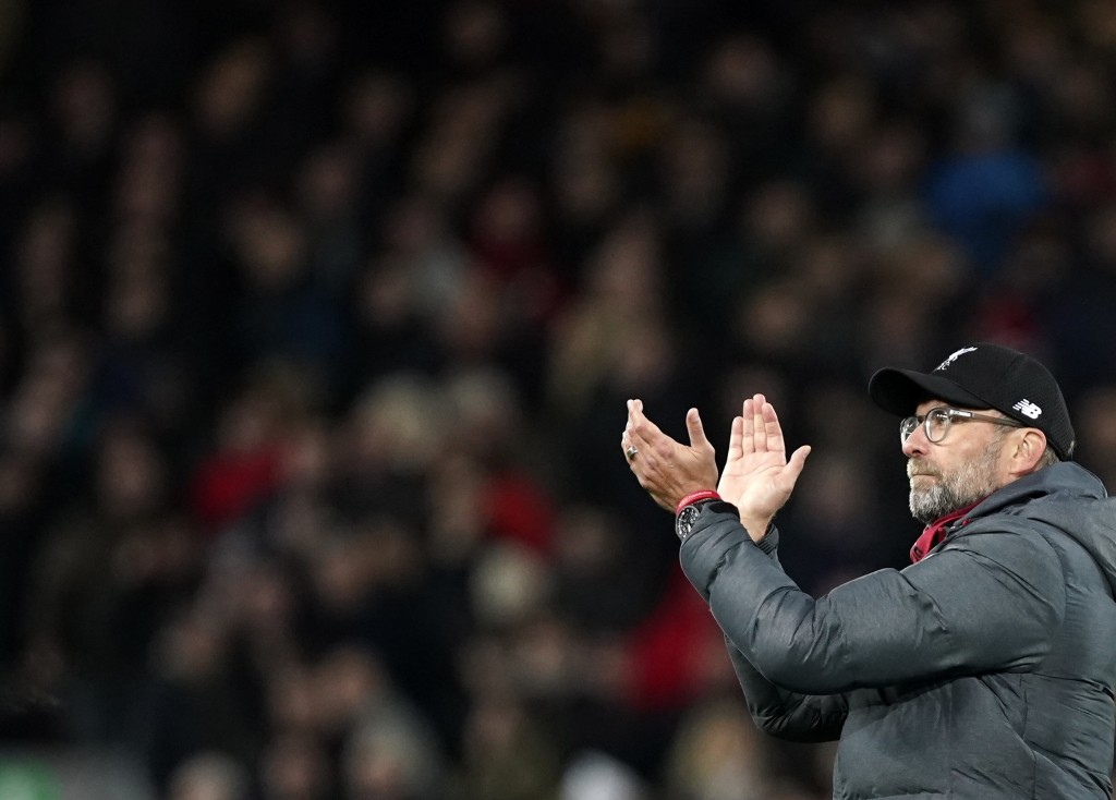 Liverpool's manager Jurgen Klopp applauds to supporters at the end of the English Premier League soccer match between Liverpool and Sheffield United a...