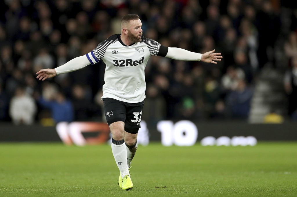 Derby County's Wayne Rooney gestures to his team-mates during the match against Barnsley, during their English Championship soccer match at Pride Park...