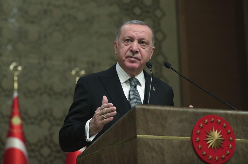 Turkey's President Recep Tayyip Erdogan deliver a speech at an event in Ankara, Turkey,Thursday, Jan. 2, 2020. Turkey's parliament on Thursday authori...