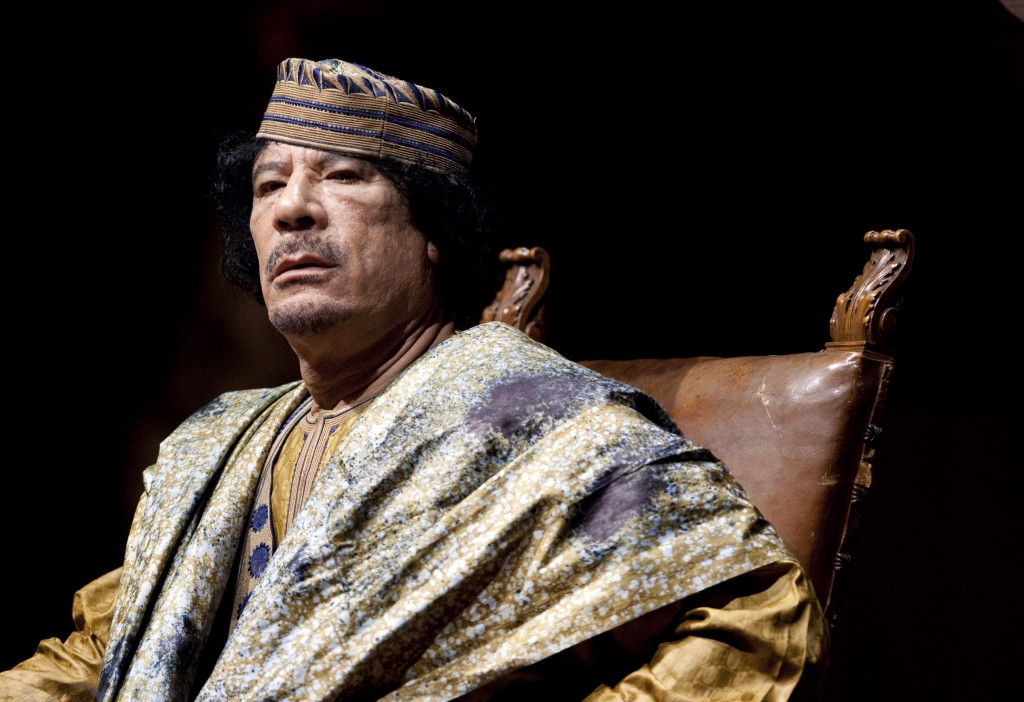 FILE - In this June 12, 2009 file photo, Libyan leader Muammar Gadhafi delivers his speech during a meeting with hundreds of prominent Italian women i...