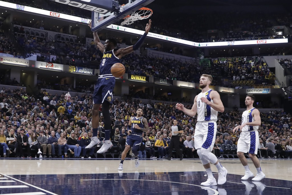Denver Nuggets' Jerami Grant (9) dunks during the first half of the team's NBA basketball game against the Indiana Pacers, Thursday, Jan. 2, 2020, in ...