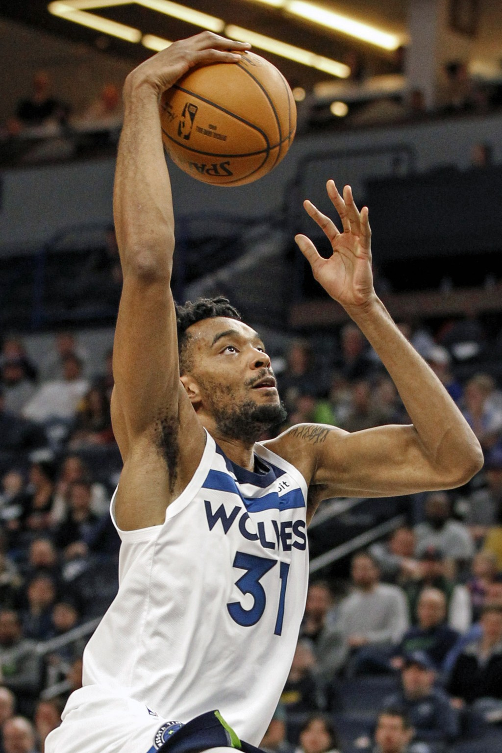 Minnesota Timberwolves forward Keita Bates-Diop dunks the ball against the Golden State Warriors in the first half of an NBA basketball game Thursday,...