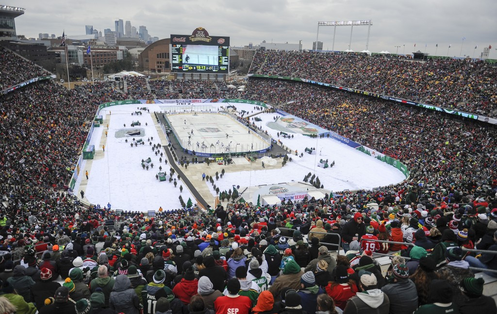 FILE - In this Feb. 21, 2016, file photo, more than 50,000 fans watch the Minnesota Wild play the Chicago Blackhawks at TCF Bank Stadium during the NH...