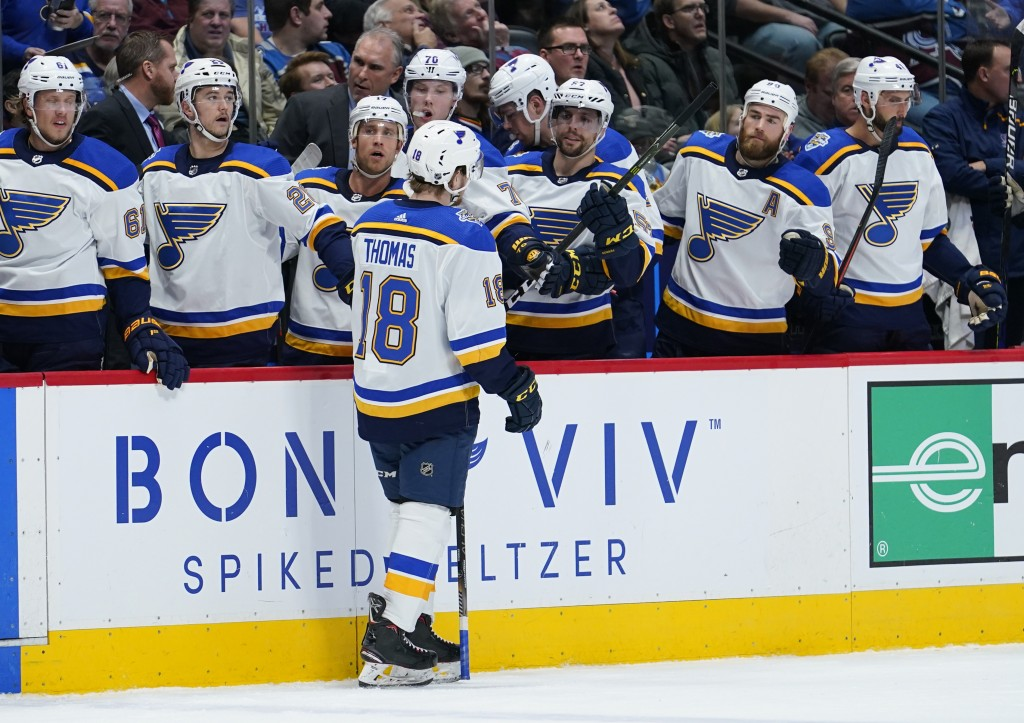St. Louis Blues center Robert Thomas (18) celebrates a goal against the Colorado Avalanche with teammates on the bench during the second period of an ...