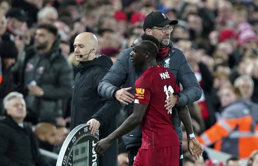 Liverpool's manager Jurgen Klopp embraces Liverpool's Sadio Mane during the English Premier League soccer match between Liverpool and Sheffield United...