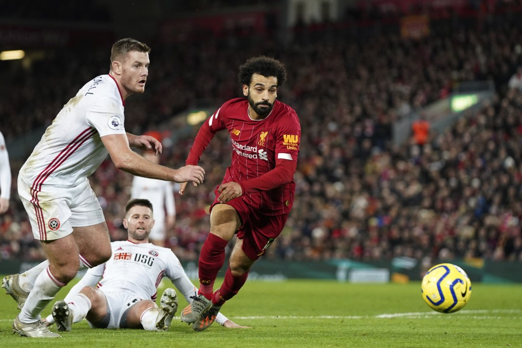 Sheffield United's Jack O'Connell, left, and Liverpool's Mohamed Salah run for the ball during the English Premier League soccer match between Liverpo...